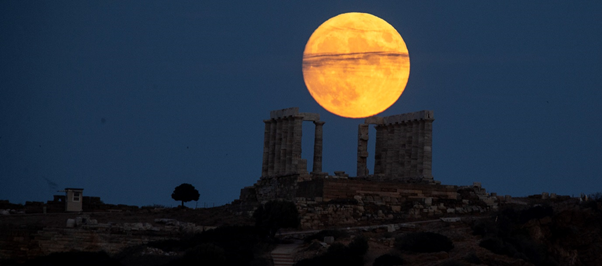 Moon rising over Temple of Poseidon